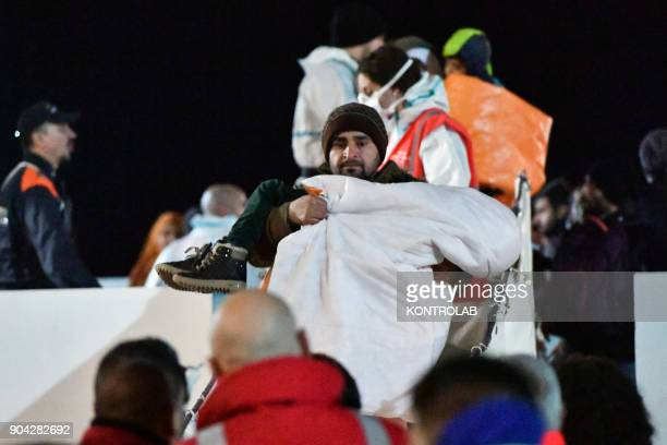 A migrant during the landing by ship Diciotti of the Italian Coast Guard occurred in the port of Crotone in Calabria southern Italy The 277...