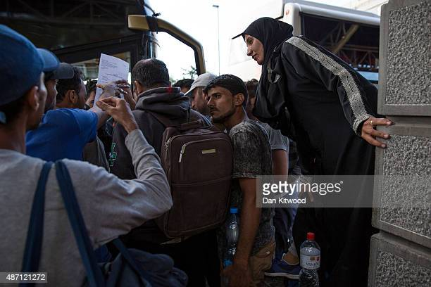 Migrant families collect their papers after disembarking a bus from Proshevo at the main bus station on September 6 2015 in Belgrade Serbia Many...
