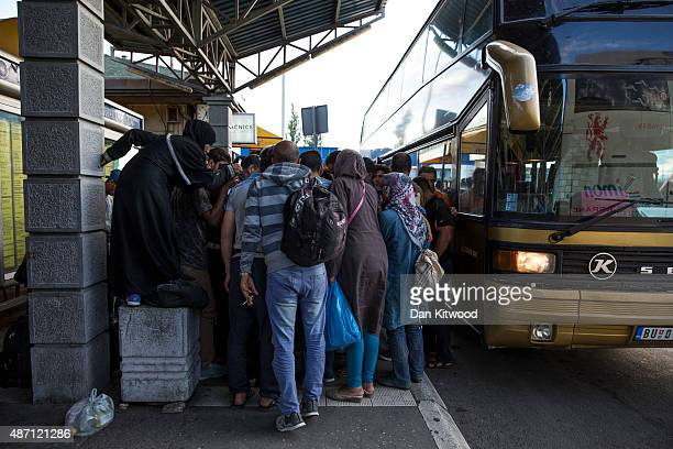 Migrant families collect their papers after disembarking from a bus from Proshevo at the main bus station on September 6 2015 in Belgrade Serbia Many...