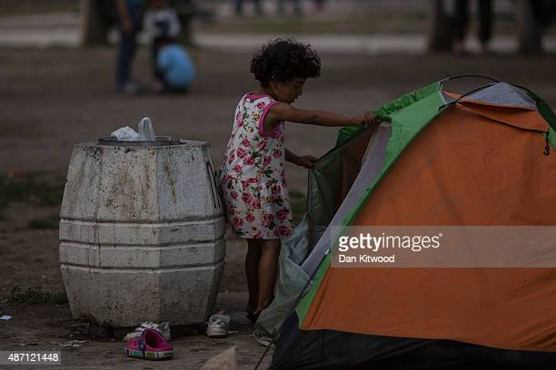Migrant families gather in a public park near the train station on September 6 2015 in Belgrade Serbia Many migrants short on financial resources and...