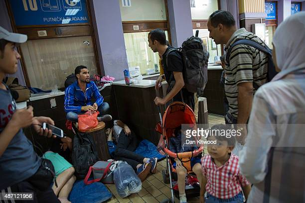 Migrant families gather in the main train station on September 6 2015 in Belgrade Serbia Many migrants short on financial resources and unsure of...