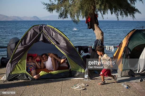 Migrant families sleep on the sea front in tents on August 31 2015 in Kos Greece Migrants from many parts of the Middle East and African nations...