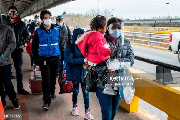 Migrant family approaches the US border on Gateway International Bridge in Brownsville, Texas on March 2, 2021. - President Biden announced that he...
