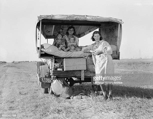 Migrant Family Heading to Arkansas Delta for Work in Cotton Fields, with Flat Tire, Texas, USA, Dorothea Lange for Farm Security Administration,...