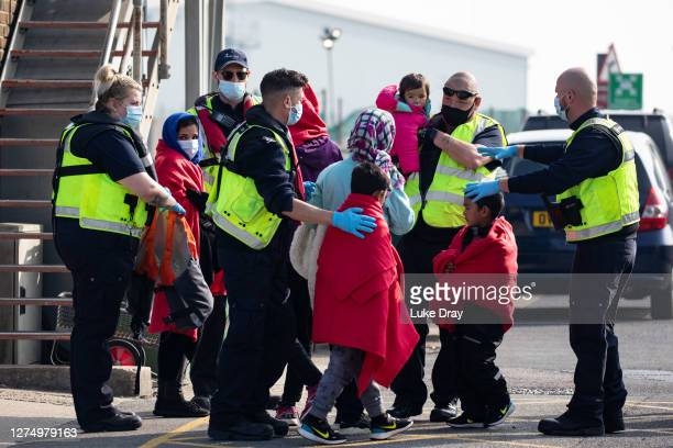 Migrant family is taken into port after being intercepted by Border Force officials in the English Channel on September 22, 2020 in Dover, England....