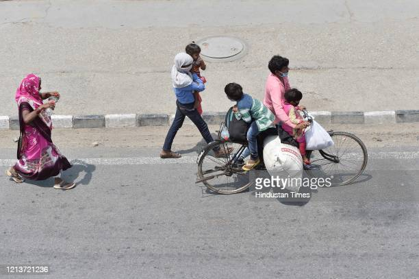 A migrant family seen at Sarai Kale Khan while journeying back to their home in Uttar Pradesh's Hardoi during lockdown on May 18 2020 in New Delhi...
