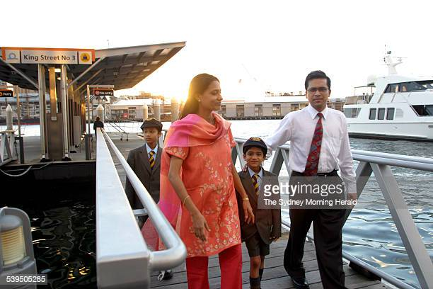 Migrant Family The Makharia family immigrated from India Ashish in orange Rekha with sons Yashovardhan 9 years old and Harshvardhan 7 years Taken at...