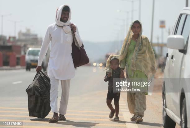 Migrant family walking towards Uttar Pradesh along Agra highway, on May 16, 2020 in Jaipur, India.
