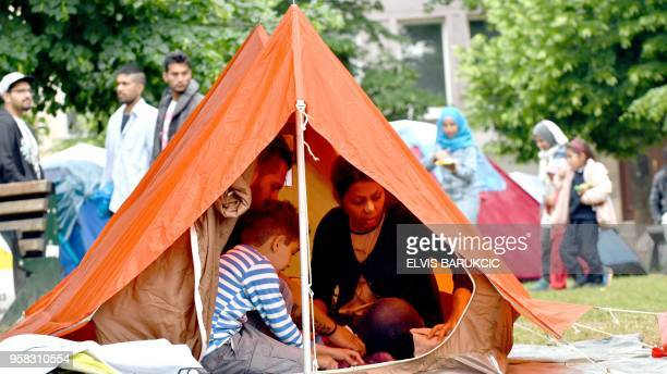Migrant family with children rest inside their tent in the park accross from The City hall in Sarajevo on May 14 2018 Numbers of migrants who are...