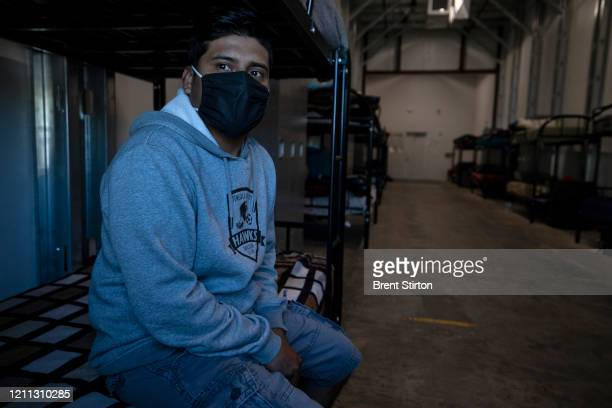 A migrant farm laborer from Fresh Harvest working with an H2A visa waits in his new dormitory to hear what shift he will work April 27 2020 in King...
