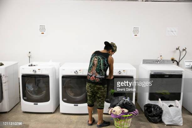 A migrant farm laborer with Fresh Harvest working with an H2A visa does laundry in the company living quarters on April 28 2020 in King City...