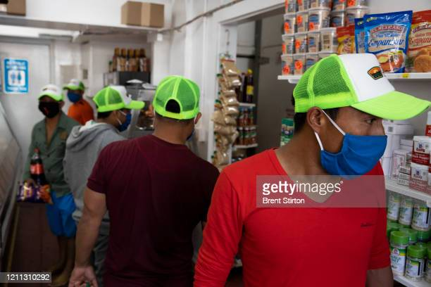 Migrant farm laborers from Fresh Harvest working with an H2A visa shop in town on April 27 2020 in King City California Fresh Harvest has...