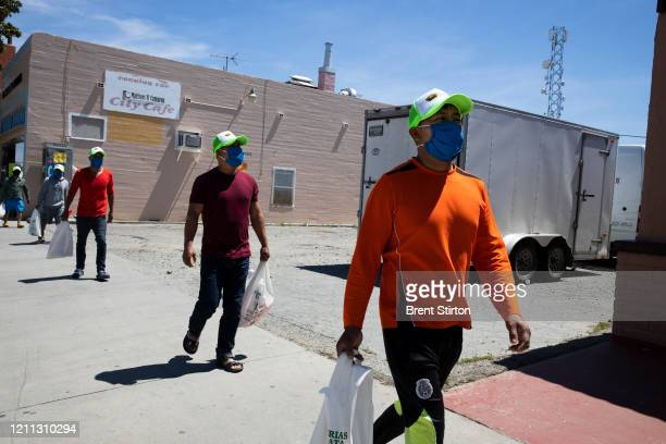 Migrant farm laborers from Fresh Harvest working with an H2A visa walk in town on April 27 2020 in King City California Fresh Harvest has...