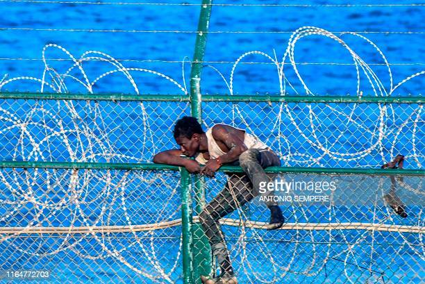 Migrant forces his way into the Spanish territory of Ceuta on August 30, 2019. Over 150 migrants made their way into Ceuta after storming a...