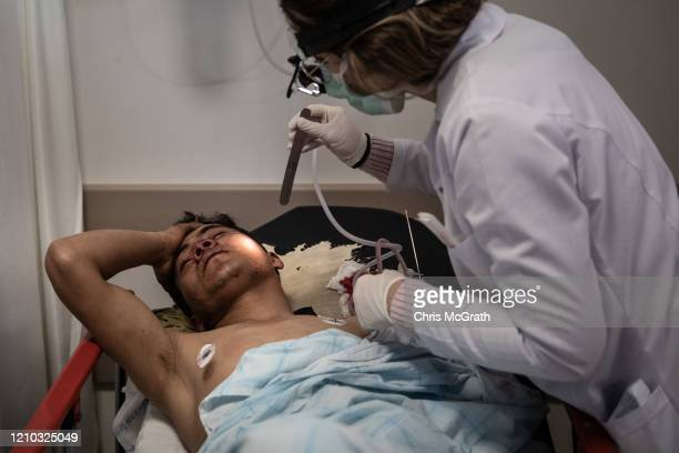 A migrant from Afghanistan recovers in hospital after suffering a head injury by Greek border guards after clashes between migrants and Greek border...