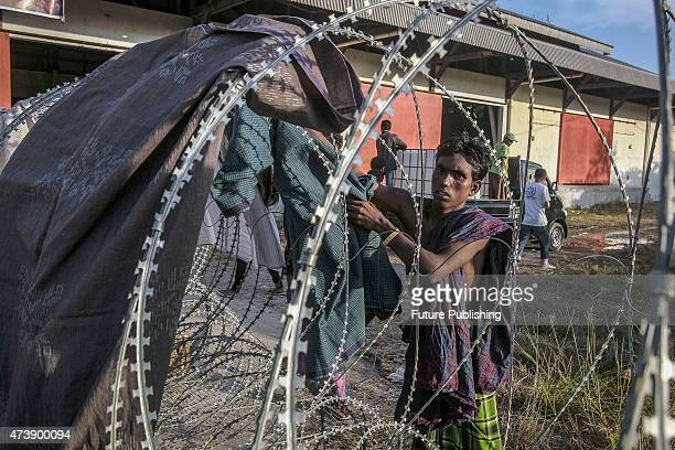 A migrant from Bangladesh seen outside the makeshift camp on May 18 2015 in Kuala Langsa Indonesia Malaysia said on Sunday that its foreign minister...