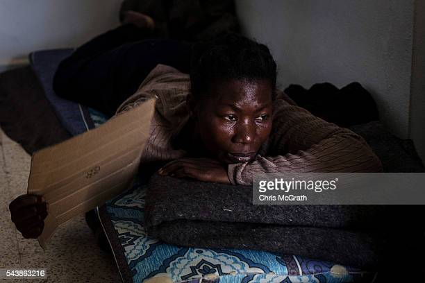 Migrant from Ivory Coast relaxes at a house provided by the Red Crescent on June 29, 2016 in Zarzis, Tunisia. Since 2012, the Tunisian border town of...