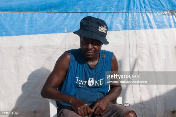 A migrant from Mali who has lived in the Rosarno ghetto since 2011 poses for a portrait in the old camp on August 9 2017 in Reggio Calabria Italy The...