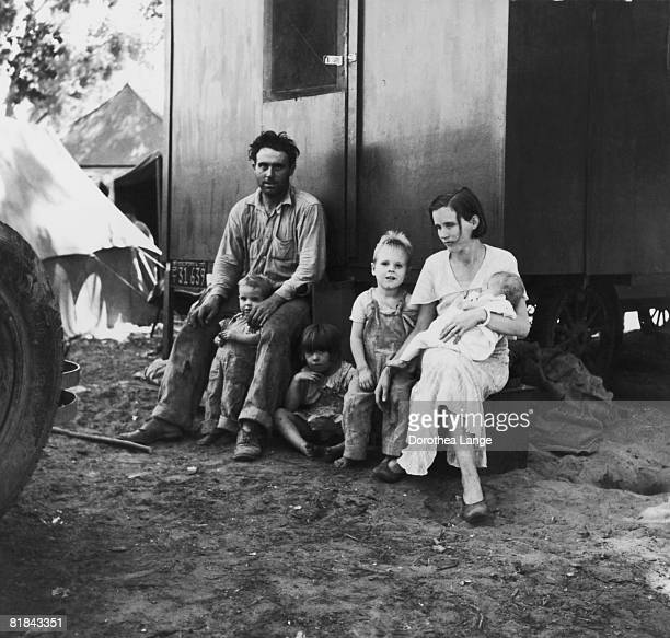 A migrant fruitpicker and his family at Marysville Migrant Camp Yuba County California June 1935