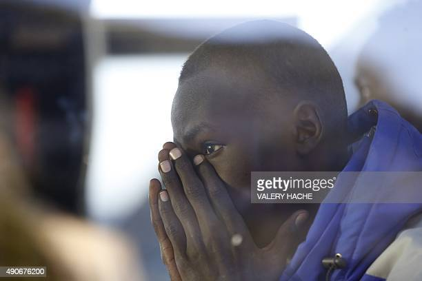 A migrant gestures after getting in a bus on September 30 2015 at the FrenchItalian border in Ventimiglia the town which became a flashpoint at the...