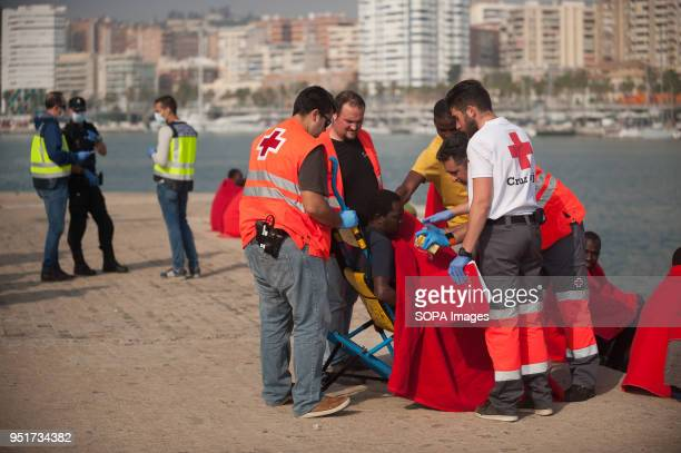 A migrant in a wheelchair is assisted by members of Spanish Red Cross after being rescued by a Spanish coast guard vessel A group of 80 migrants were...