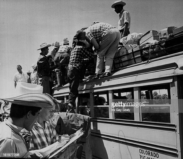 JUL 2 1959 JUL 12 1959 JUN 3 1960 JUN 5 1960 Migrant Labor Colo Great Western employe checks a Bracero's name against the trip roster as others load...