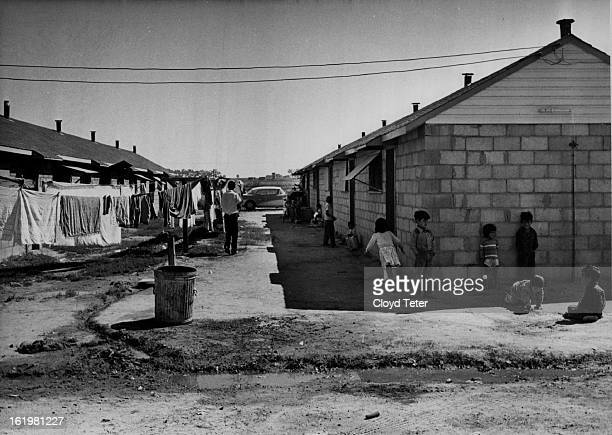 Migrant Labor - Colo.; Street scene in Fort Lupton camp is dominated by children. It is not unusual for women of 40 to have 10, even 13 children....