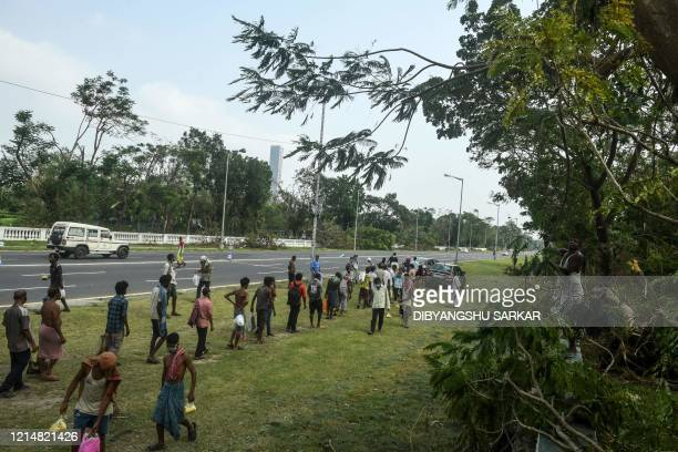 Migrant labourers and people stranded away from their hometowns due to the consequences following the landfall of cyclone Amphan and the restrictions...