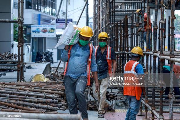 Migrant labourers go back to work for the Kochi Metro construction project after the governmentimposed nationwide lockdown as a preventive measure...