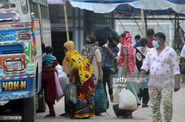 Migrant labourers to board a bus to go their native place return from Maharashtra by train in Barasat, District of North 24 Parganas at outskirts of...