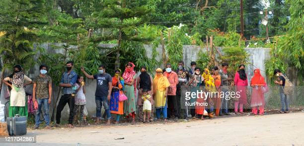 Migrant labourers waits for bus to go their native place return from Maharashtra by train in Barasat, District of North 24 Parganas at outskirts of...