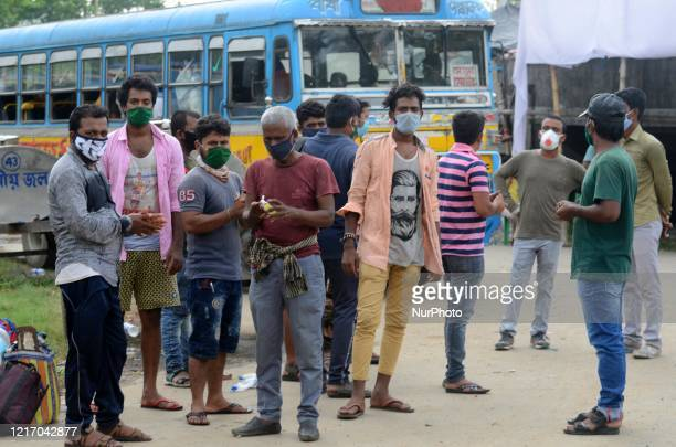 Migrant labourers waits for bus to go their native place return from Tamil Nadu by train in Barasat, District of North 24 Parganas at outskirts of...
