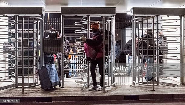 A migrant leaves the official part of the Calais Jungle via a revolving door The refugee camp on the coast to the English Channel is to be cleared...