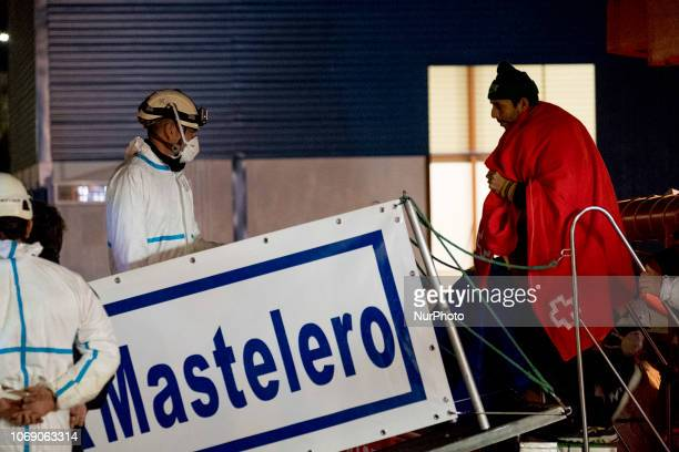 A migrant leaving the vessel to be transferred to the Red Cross Care unit Malaga