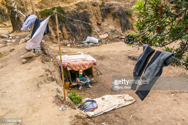 usa/mexico border - the wall - immigrants crossing sign stock photos and pictures