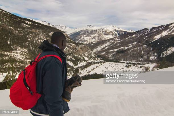 A migrant look at the mountains climbing Colle della Scala during another attempt to reach the French border on December 22 2017 in Bardonecchia...