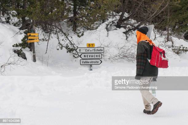A migrant look at the signs after crossing the French border on December 22 2017 in Bardonecchia Turin Italy After the police reinforced the Frejus...