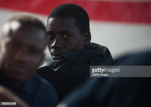Migrant looks on after his arrival at Port of Malaga. Members of the Spanish Maritime Safety rescued 56 sub-Saharan migrants aboard a dinghy near the...
