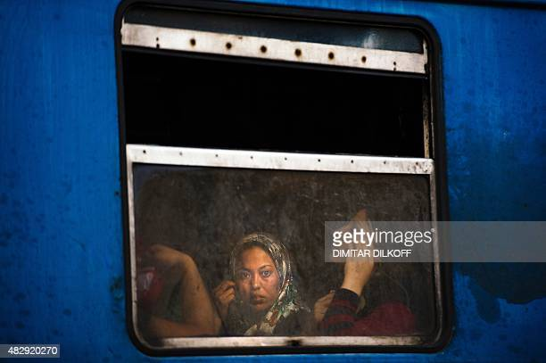 A migrant looks out the window of a train heading to the border with Serbia at the train station in Gevgelija on the MacedonianGreek border on August...