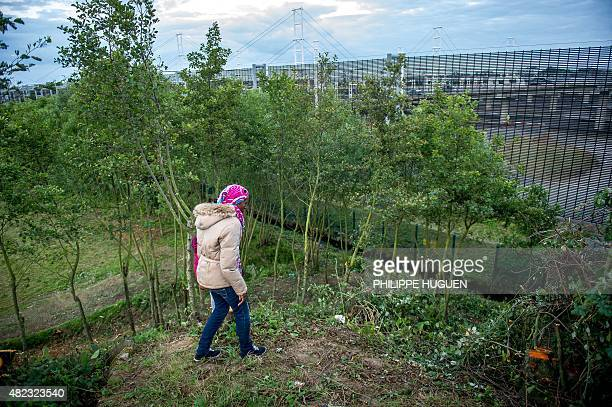 A migrant looks towards the boarding docks on the Eurotunnel site in Coquelles near Calais northern France on late July 29 2015 One man died...