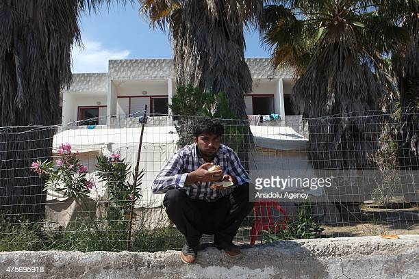 A migrant man is seen after getting food aid in Greece's Kos on June 3 2015 A great number of immigrants who pass through illegal routes to Istanköy...