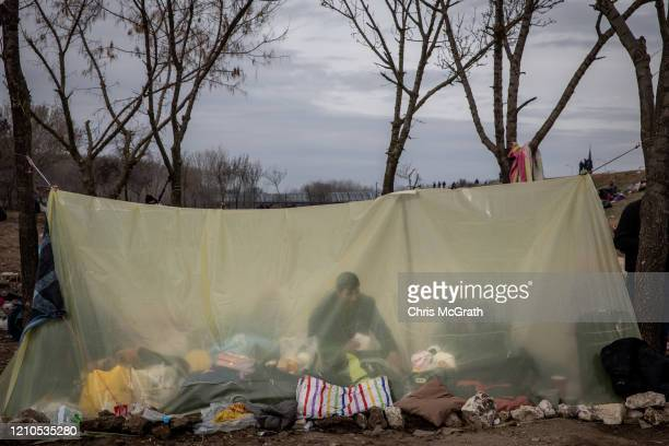 A migrant man is seen inside a plastic tent at a makeshift camp for refugees and migrants next to the Edirne Old Bridge on March 05 2020 in Edirne...