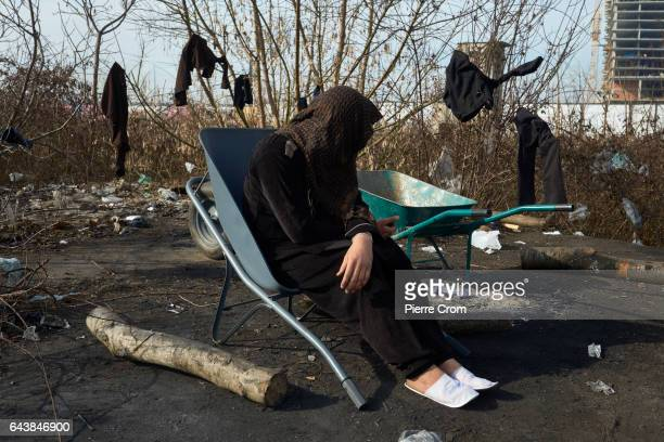 A migrant man sits in a chair looking at his smartphone on February 22 2017 in Belgrade SerbiaMigrants on a journey to Western Europe mostly from...
