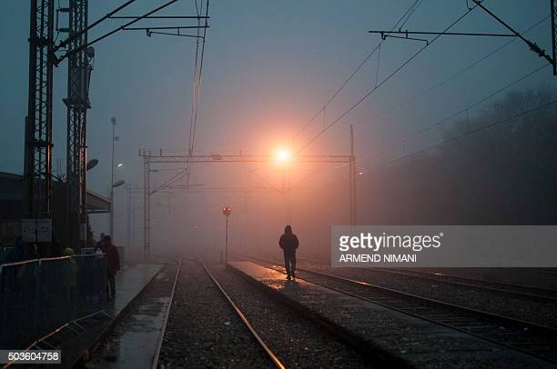 A migrant man walks on a platform as he waits with other migrants for a train in southern Serbian town of Presevo on January 6 2016 The International...