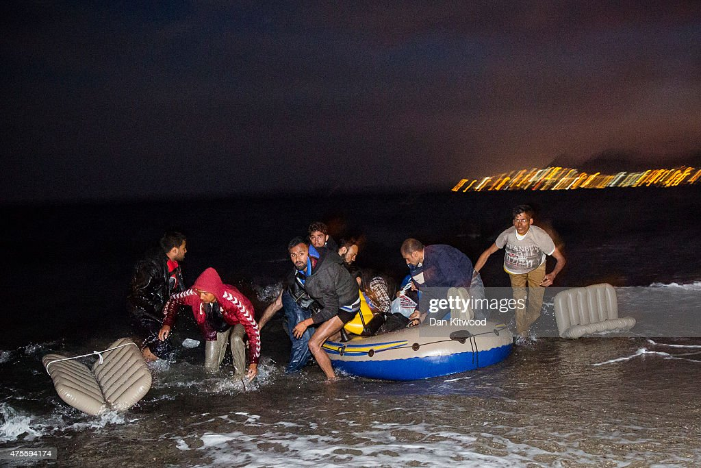Migrant men arrive on the beach in a dinghy at dawn after making their way from Turkey on June 02, 2015 in Kos, Greece. Migrants are continuing to arrive on the Greek Island of Kos from Turkey who's shoreline lies approximately 5 Km away. Around 30,000 migrants have entered Greece so far in 2015, with the country calling for more help from its European Union counterparts.