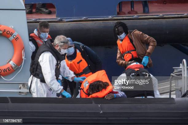Migrant men picked up by the UK Border Force arrive at Dover Port on August 20 2020 in Dover England Favourable weather conditions in recent weeks...