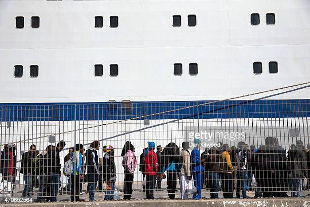 Migrant men wait to board a ship bound for Sicily on April 22, 2015 in Lampedusa, Italy. Migrants continue to arrive in Lampedusa from North Africa...