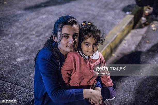 A migrant mother and child wait and sleep at the Port of Pireus on March 1 2016 in Athens Greece Border restrictions further north in the Balkans...