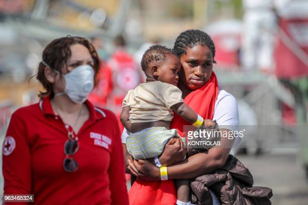 PORT PALERMO SICILY ITALY A migrant mother with her son and a Red Cross volunteer during the stages of landing of 600 migrants at the port of Palermo...