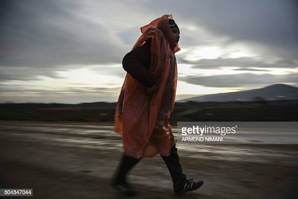 TOPSHOT A migrant or refugee walks after crossing the Macedonian border into Serbia near the village of Miratovac on January 10 2016 More than a...